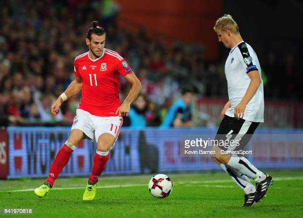 Wales Gareth Bale under pressure from Austrias Martin Hinteregger during the FIFA 2018 World Cup Qualifier between Wales and Austria at Cardiff City...