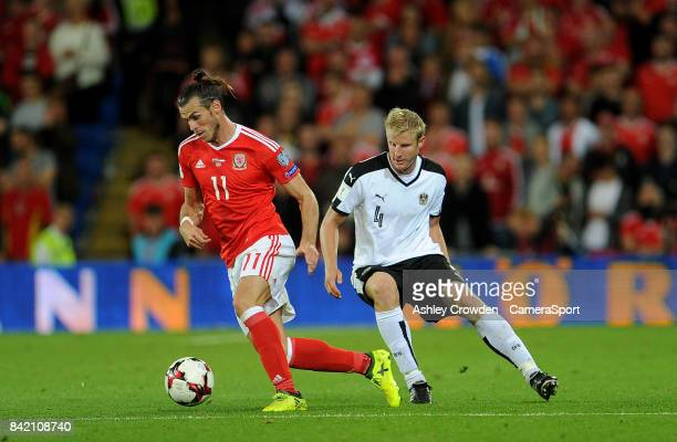 Wales Gareth Bale vies for possession with Austrias Martin Hinteregger during the FIFA 2018 World Cup Qualifier between Wales and Austria at Cardiff...