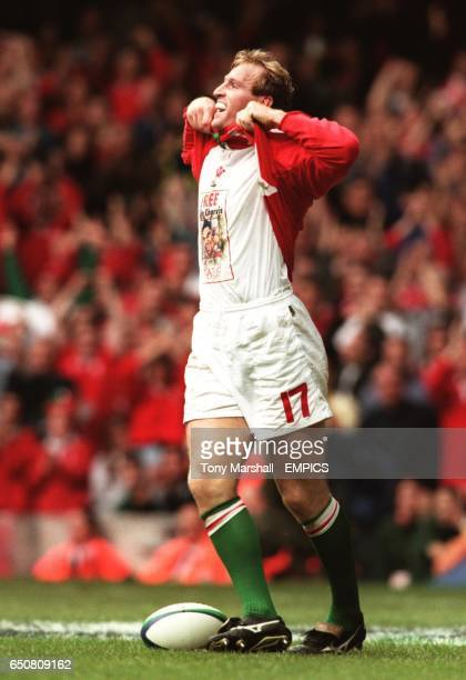 Wales' Gareth Thomas celebrates after scoring a try His Tshirt reads Colin Charvis is innocent in reference to his team mate's sending off last week...
