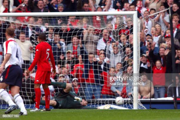 Wales' goalkeeper Paul Jones is unable to get a hand on the ball and England's Frank Lampard scores the opening goal