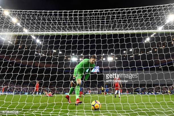 Wales' goalkeeper Wayne Hennessey catches the ball after France's forward Olivier Giroud scored a goal during the friendly football match between...
