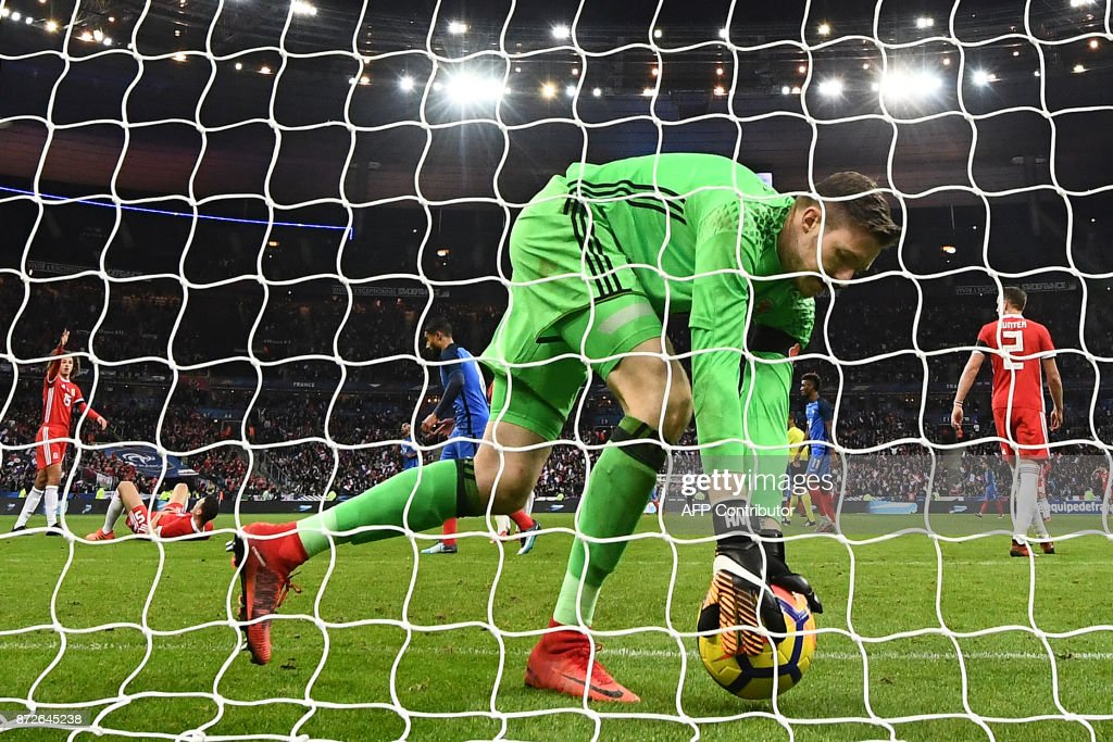 Wales' goalkeeper Wayne Hennessey catches the ball after France's forward Olivier Giroud scored a goal during the friendly football match between France and Wales at the Stade de France stadium, in Saint-Denis, on the outskirts of Paris, on November 10, 2017. /