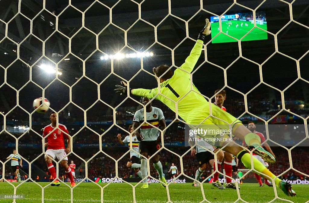 Wales' goalkeeper Wayne Hennessey jumps for the ball during the Euro 2016 quarter-final football match between Wales and Belgium at the Pierre-Mauroy stadium in Villeneuve-d'Ascq near Lille, on July 1, 2016. / AFP / Emmanuel DUNAND