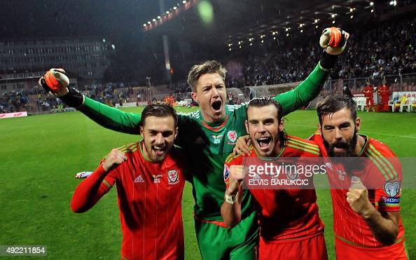 Wales' goalkeeper Wayne Hennessey midfielder Gareth Bale midfielder Joe Ledley and midfielder Aaron Ramsey salute supporters after the Euro 2016...