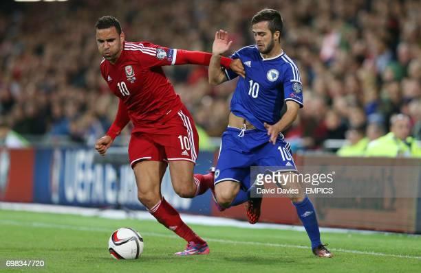 Wales' Hal RobsonKanu and Bosnia Herzegovina's Miralem Pjanic battle for the ball