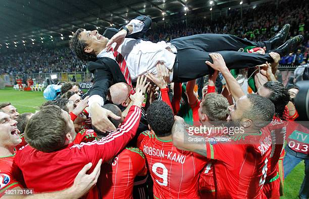 Wales head coach Chris Coleman celebrate with players after the Euro 2016 qualifying football match between Bosnia and Herzegovina and Wales at the...