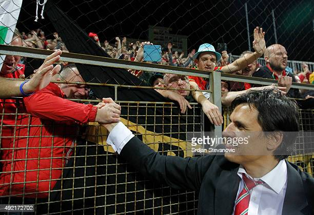 Wales head coach Chris Coleman celebrates with the fans the Euro 2016 qualifying football match between Bosnia and Herzegovina and Wales at the...