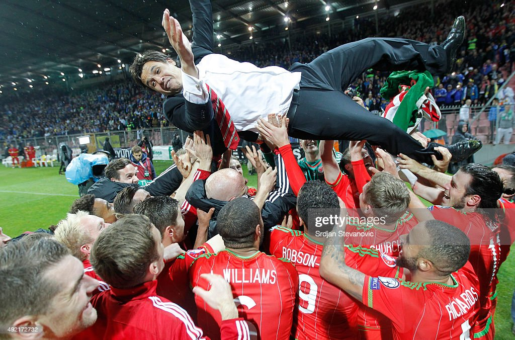 Wales head coach Chris Coleman is thrown in the air as he celebrate with players after the Euro 2016 qualifying football match between Bosnia and...