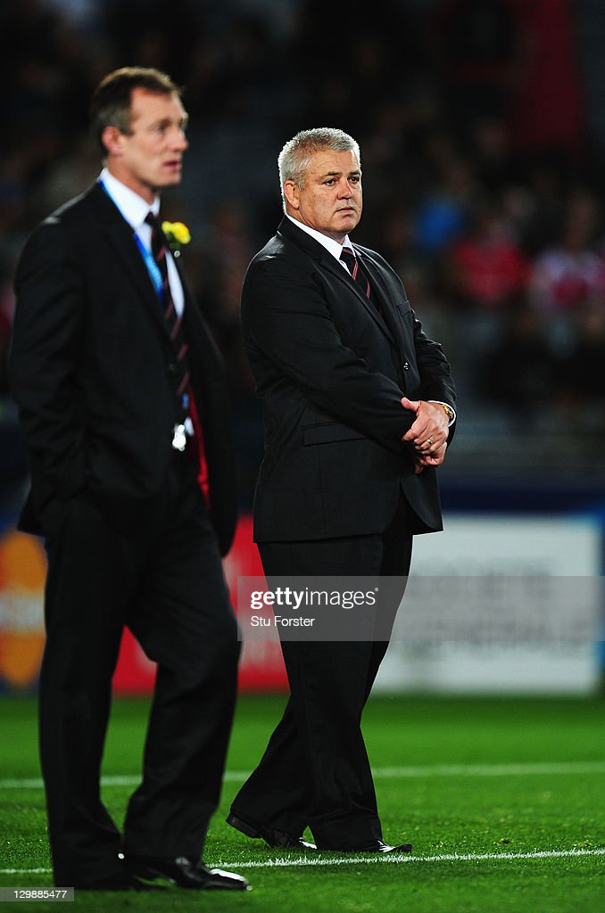 Wales head coach Warren Gatland (R) and his assistant coach Rob Howley (L) watch over the pre match warm up prior to kickoff during the 2011 IRB Rugby World Cup bronze final match between Wales and Australia at Eden Park on October 21, 2011 in Auckland, New Zealand.