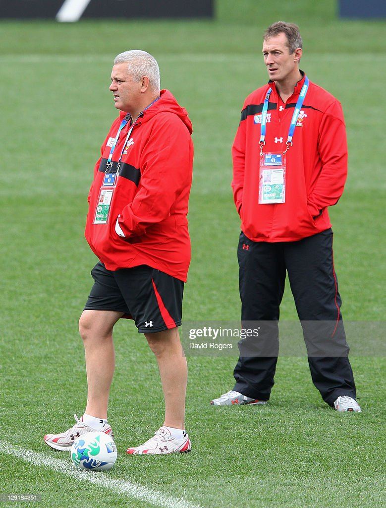 Wales head coach Warren Gatland and Rob Howley the Wales Skill coach loomk on during a Wales IRB Rugby World Cup 2011 captain's run at Eden Park on October 14, 2011 in Auckland, New Zealand.