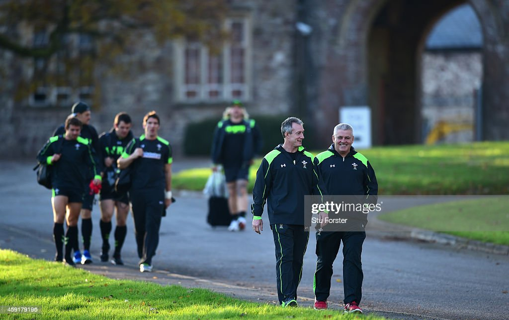 Wales head coach <a gi-track='captionPersonalityLinkClicked' href=/galleries/search?phrase=Warren+Gatland&family=editorial&specificpeople=686626 ng-click='$event.stopPropagation()'>Warren Gatland</a> (R) shares a joke with assistant <a gi-track='captionPersonalityLinkClicked' href=/galleries/search?phrase=Rob+Howley&family=editorial&specificpeople=215419 ng-click='$event.stopPropagation()'>Rob Howley</a> as they and the players make their way to training at the Vale Hotel, on November 18, 2014 in Cardiff, Wales.