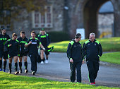 Wales head coach Warren Gatland shares a joke with assistant Rob Howley as they and the players make their way to training at the Vale Hotel on...