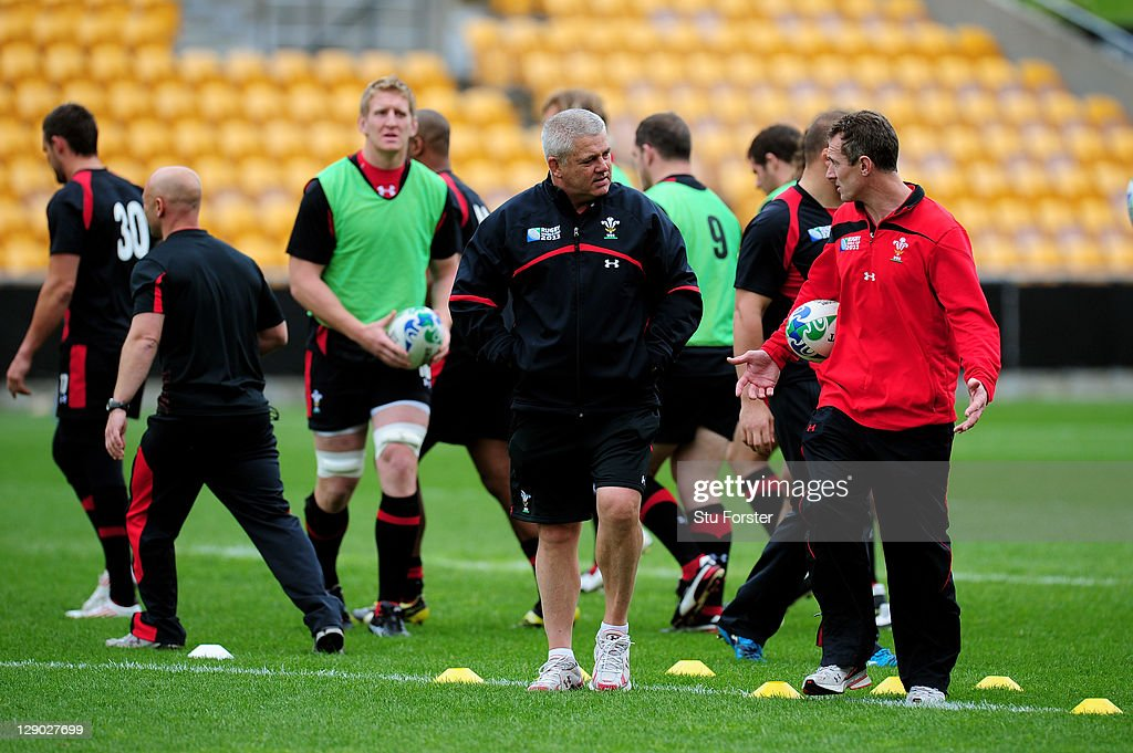 Wales head coach Warren Gatland (L) speaks with his assistant coach Rob Howley (R) during a Wales IRB Rugby World Cup 2011 training session at Mt Smart Stadium on October 11, 2011 in Auckland, New Zealand.