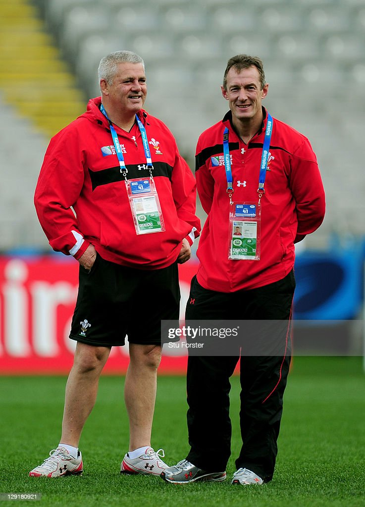 Wales head coach <a gi-track='captionPersonalityLinkClicked' href=/galleries/search?phrase=Warren+Gatland&family=editorial&specificpeople=686626 ng-click='$event.stopPropagation()'>Warren Gatland</a> (L) speaks with his assistant coach <a gi-track='captionPersonalityLinkClicked' href=/galleries/search?phrase=Rob+Howley&family=editorial&specificpeople=215419 ng-click='$event.stopPropagation()'>Rob Howley</a> (R) during a Wales IRB Rugby World Cup 2011 captain's run at Eden Park on October 14, 2011 in Auckland, New Zealand.