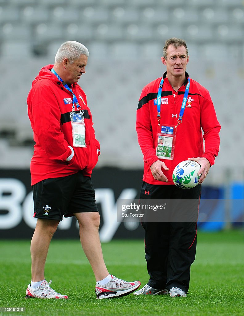 Wales head coach Warren Gatland (L) speaks with his assistant coach Rob Howley (R) during a Wales IRB Rugby World Cup 2011 captain's run at Eden Park on October 14, 2011 in Auckland, New Zealand.