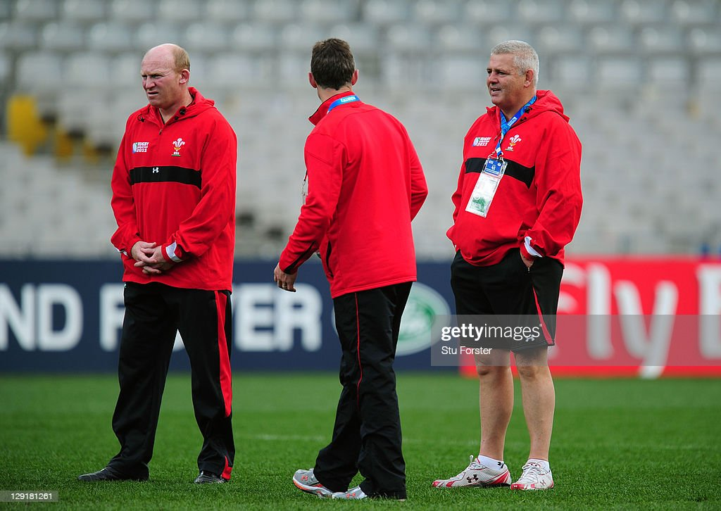 Wales head coach Warren Gatland (R) speaks with his assistant coaches Neil Jenkins (L) and Rob Howley (C) during a Wales IRB Rugby World Cup 2011 captain's run at Eden Park on October 14, 2011 in Auckland, New Zealand.