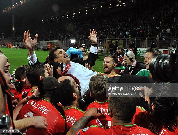 Wales' headcoach Chris Coleman celebrates with his team after the Euro 2016 qualifying football match between Bosnia and Herzegovina and Wales in...