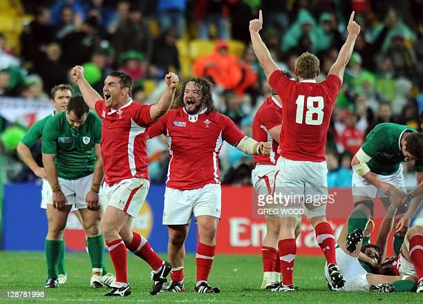 Wales' hooker Huw Bennett prop Adam Jones and Wales' Bradley Davies react next to Ireland's players after the 2011 Rugby World Cup quarterfinal match...