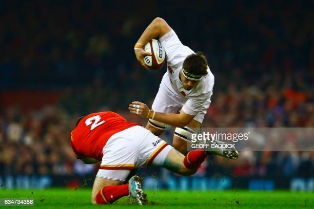 TOPSHOT Wales' hooker Ken Owens tackles England's flanker Jack Clifford during the Six Nations international rugby union match between Wales and...