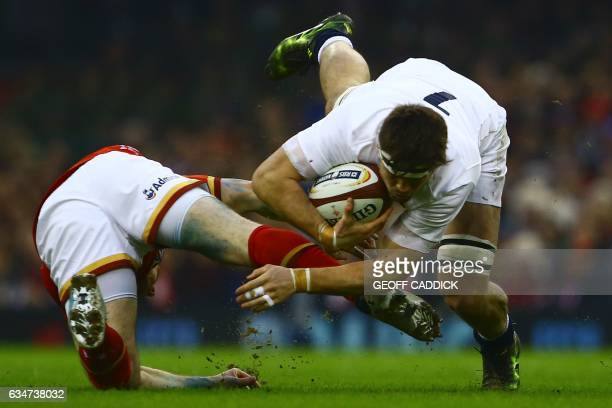 Wales' hooker Ken Owens tackles England's flanker Jack Clifford during the Six Nations international rugby union match between Wales and England at...