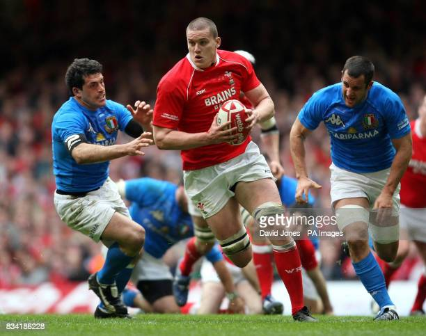 Wales' Ian Evans charges through Italy's defence during the RBS 6 Nations match at the Millennium Stadium Cardiff