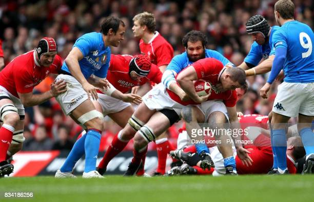 Wales' Ian Evans is tackled by Italy's Martin Castrogiovanni during the RBS 6 Nations match at the Millennium Stadium Cardiff