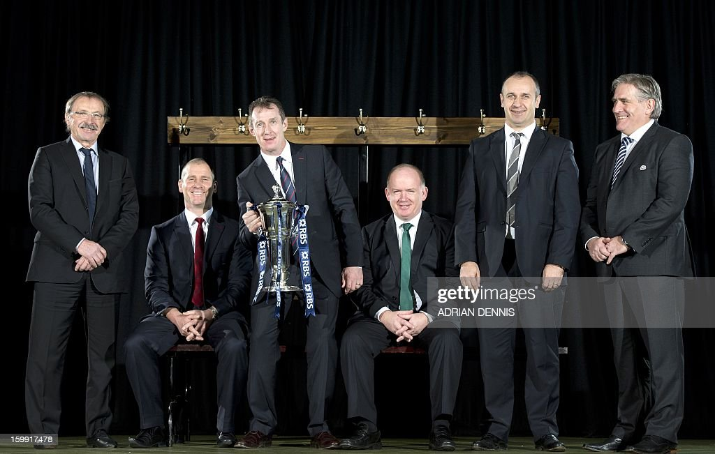 Wales' interim head coach Rob Howley (3rd L) poses with the trophy alongside coaches Italy's Jacques Brunel (L), England's Stuart Lancaster (2nd L), Ireland's Declan Kidney (3rd R), France's Philippe Saint-Andre (2nd R) and Scotland's Scott Johnson (R) during a photocall at the official launch of the 2013 Six Nations International rugby tournament at the Hurlingham Club in London on January 23, 2013. The tournament kicks-off February 2 with Wales versus Ireland. AFP PHOTO / ADRIAN DENNIS / AFP / Adrian DENNIS