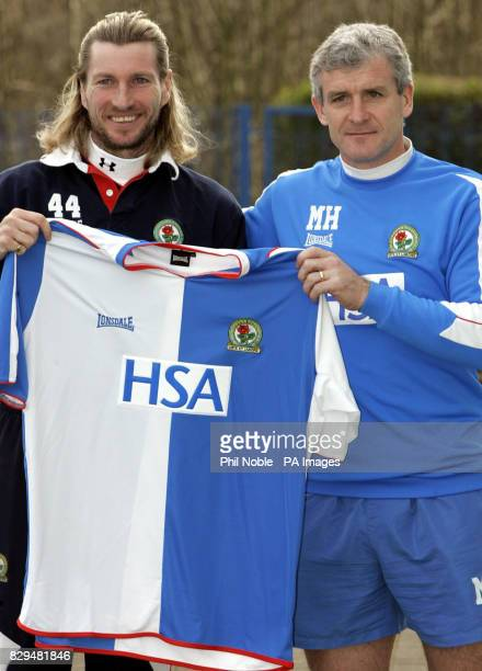 Wales international Robbie Savage smiles as he poses with Blackburn Rovers manager Mark Hughes after completing his 3million move from Birmingham City