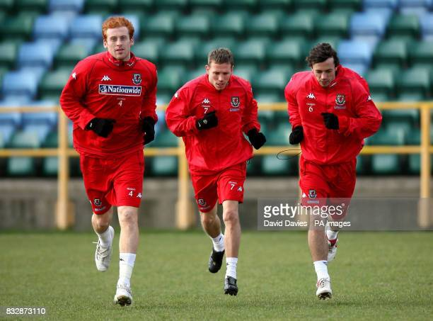 Wales' James Collins Craig Bellamy and Simon Davies during a training session at Jenner Park Barry