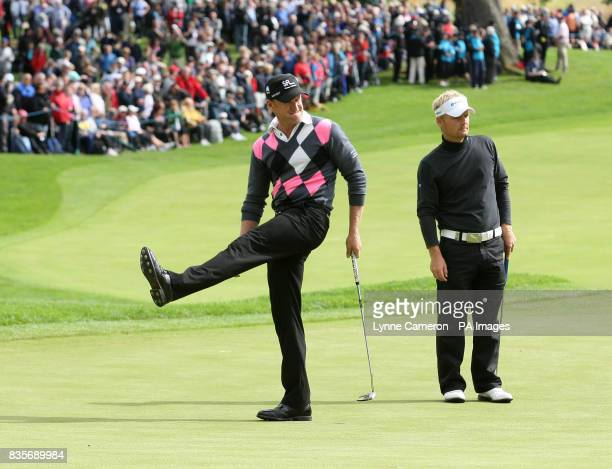 Wales' Jamie Donaldson reacts to a putt as Denmark's Soren Kjeldsen looks on on the 18th green during the Barclays Scottish Open at Loch Lomond...