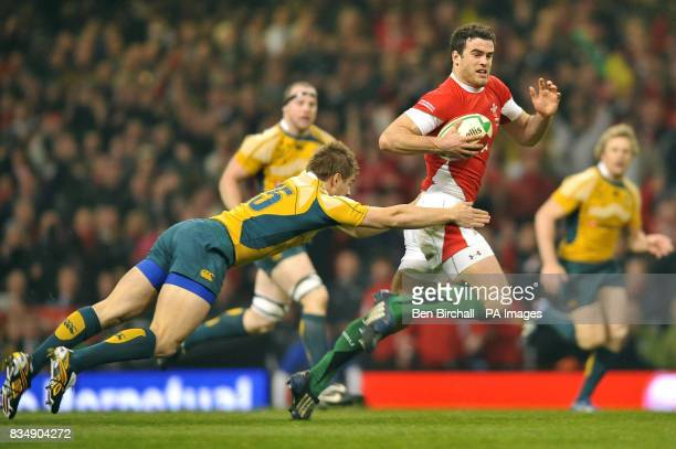 Wales' Jamie Roberts beats Australia's Drew Mitchell during the Invesco Perpetual Series match at the Millennium Stadium Cardiff