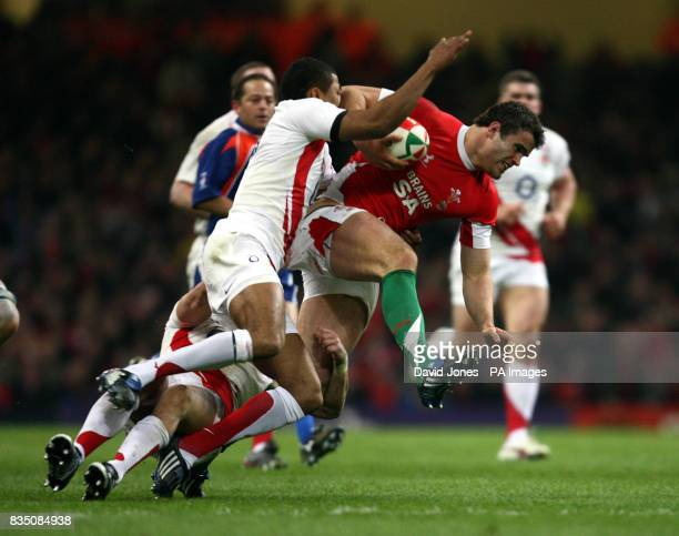 Wales' Jamie Roberts bursts through England's Delon Armitage and Harry Ellis during the RBS 6 Nations match at the Millennium Stadium Cardiff