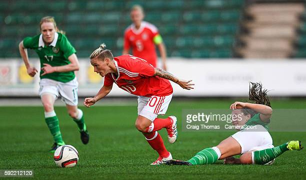 Wales Jess Fishlock evades the challenge from Irelands Katie McCabe during the Women's B International Friendly Challenge match between Wales and...