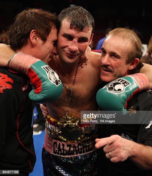Wales' Joe Calzaghe celebrates his points victory over USA's Roy Jones Joe Calzaghe with his father and trainer Enzo and uncle Sergio after the...