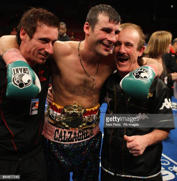 Wales' Joe Calzaghe celebrates with his father and trainer Enzo and uncle Sergio celebrates after his points victory over USA's Roy Jones after the...