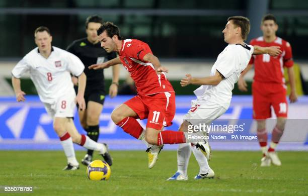 Wales' Joe Ledley is fouled during the International Friendly at the Vila Real De Santo Antonio Sports Complex Portugal