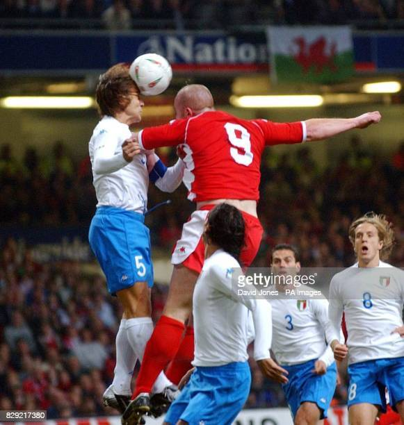 Wales' John Hartson is beaten to a high ball by Italy's Fabio Cannavaro during tonight's Euro 2004 qualifying match at The Millennium Stadium Cardiff