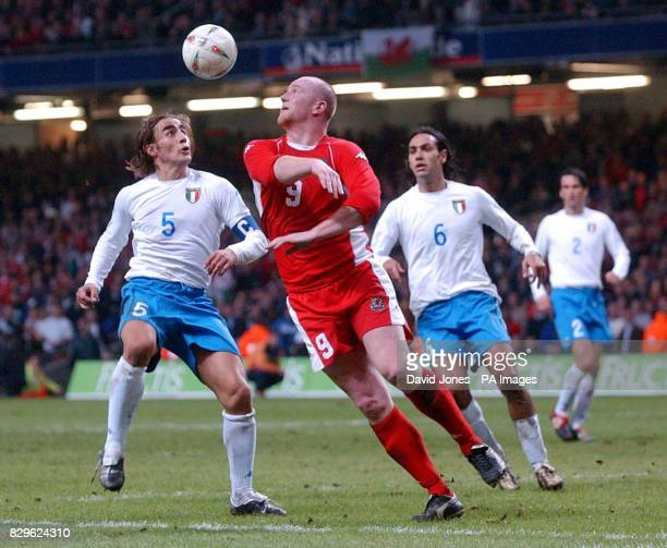 Wales' John Hartson is challenged by Italy's Fabio Cannavaro as Alessandro Nesta looks on during Euro 2004 Group 9 Qualifying match at the Millennium...