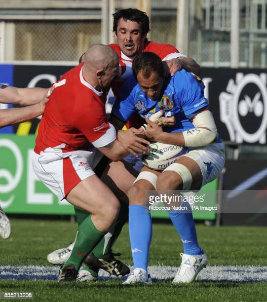 Wales' John Yapp and Jonathan Thomas tackle Italy's Sergio Parisse during the RBS 6 Nations match at the Stadio Flaminio Rome Italy