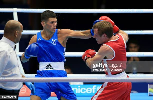 Wales' Joseph Cordina in action against Canada's David Gauthier in the Men's Light Round of 16 at the SECC during the 2014 Commonwealth Games in...