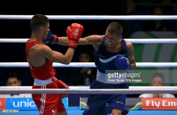 Wales Joseph Cordina in action against England's Pat McCormack in the Men's Light Round of 32 at the SECC during the 2014 Commonwealth Games in...