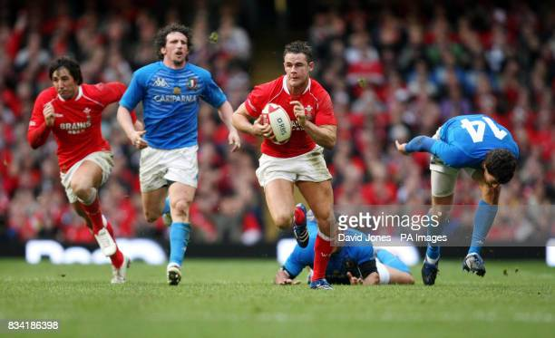 Wales' Lee Byrne breaks the Italian defensive line as he runs in to score his second try during the RBS 6 Nations match at the Millennium Stadium...