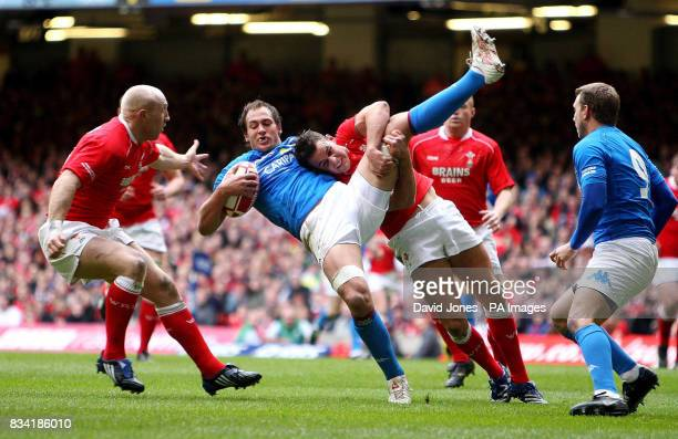 Wales' Lee Byrne upends Italy's Sergio Parisse during the RBS 6 Nations match at the Millennium Stadium Cardiff