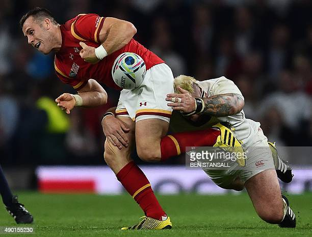 Wales' lock Alun Wyn Jones is tackled by England's prop Joe Marler during a Pool A match of the 2015 Rugby World Cup between England and Wales at...