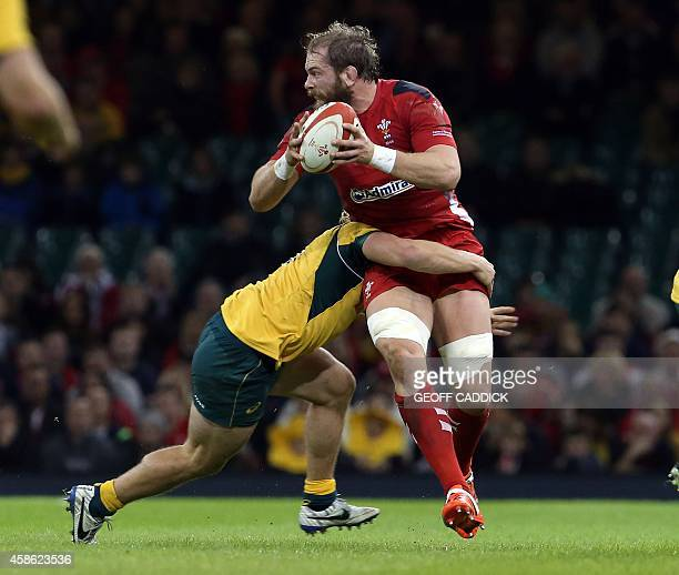 Wales' lock Alun Wyn Jones is tackled during the Autumn International rugby union Test match between Wales and Australia at the Millennium Stadium in...
