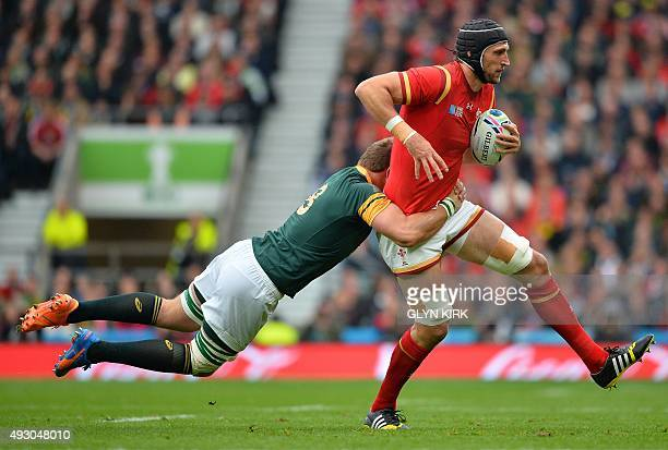 Wales' lock Luke Charteris is tackled by South Africa's number 8 Duane Vermeulen during a quarter final match of the 2015 Rugby World Cup between...