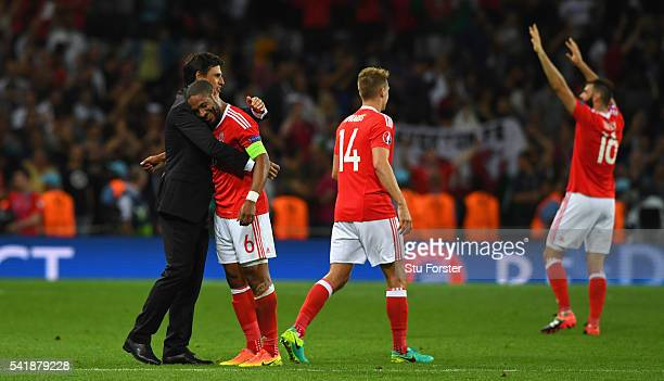 Wales manager Chris Coleman congratulates player Ashley Williams after the UEFA EURO 2016 Group B match between Russia and Wales at Stadium Municipal...