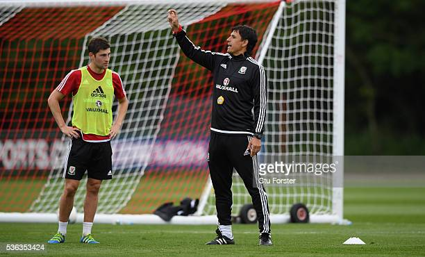 Wales manager Chris Coleman instructs his players as Ben Davies on during Wales training at the Vale hotel complex on June 1 2016 in Cardiff Wales
