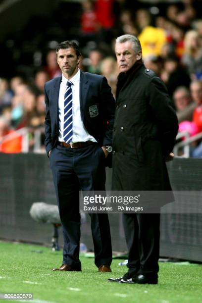Wales' Manager Gary Speed and Switzerland's Ottmar Hitzfeld on the touchline