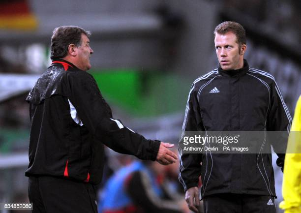 Wales manager John Toshack argues his point to fourth official Olivier Thual
